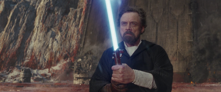 Why did Luke Skywalker use the legacy lightsaber at the end of The Last Jedi?